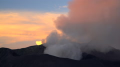 Mt Bromo at sunset an active volcano erupting smoke and ash Java Stock Footage