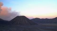 Mt Bromo volcano summit erupting delta mud flows Java National Park Indonesia Stock Footage