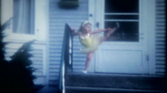 A little ballerina shows her moves to mom and dad, 3586 -vintage home movie Stock Footage