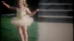 A little ballerina performs for mom and dad,  3587 -vintage home movie Stock Footage
