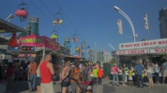 Toronto CNE The Ex Day Fair Crowds Rides Games Festival CN Tower 2 Stock Footage