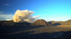 Mount Bromo volcano eruption at sunrise a mud river delta Java Indonesia Stock Footage