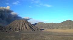 Mud river delta smoke and ash from Mt Bromo volcano Java Indonesia Stock Footage