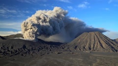 Mount Bromo volcano eruption a mud river delta Java Indonesia Stock Footage