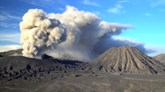 Smoke and ash erupting from Mt Bromo active volcano Java Indonesia Stock Footage
