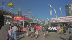Toronto CNE The Ex Day Fair Crowds Rides Games Festival CN Tower Slow Motion 2 Stock Footage