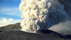 Mt Bromo active volcano erupting smoke and ash National Park Java Indonesia Stock Footage
