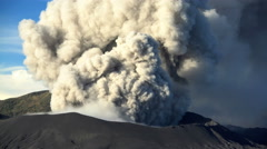 Billowing smoke erupting from Mount Bromo volcano Java Indonesia Stock Footage