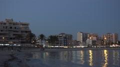 4K Pan right famous Palma Majorca cityscape at twilight city light reflection Stock Footage