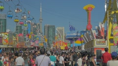 Toronto CNE The Ex Day Fair Crowds Rides Games Festival CN Tower Slow Motion Stock Footage