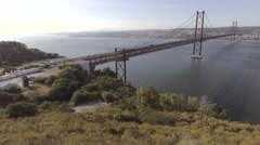 Aerial view suspension Bridge 25 De Abril Over The Tagus River In Lisbon Stock Footage