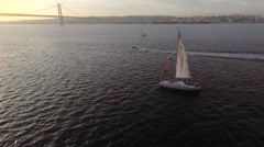 Aerial shot Of Yatch Sailing in lisbon river at sunset Stock Footage