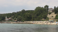 Timelapse tourist visit Balchik landmark Amazing Castle people swim in sea water Stock Footage
