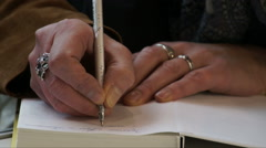 Female hands with a pen. Stock Footage