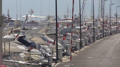 Busy port in Cannes luxurious yacht anchoring line expensive passion lifestyle Stock Footage