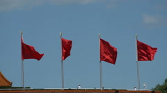 Four flying red Flags against blue sky Stock Footage
