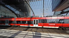 Departure of Regional Express train at main train station (Berlin Hauptbahnhof) Stock Footage
