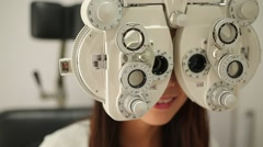 Woman doing eye test Stock Footage
