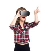 Happy girl getting experience using VR headset glasses of virtual reality, much Stock Photos