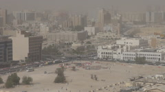 Aerial view Doha skyline in sand storm misty day famous cityscape traffic car Stock Footage