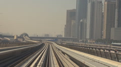 POV Point of view metro train pass in Dubai crowded city modern infrastructure Stock Footage