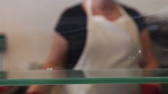 Putting tray with cakes in the pastry shop window Stock Footage