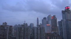 Aerial view Guangzhou modern skyscraper at twilight storm rain cloud tall tower Stock Footage