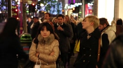 People walking in Oxford Street with Christmas decorations on London Stock Footage