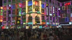 Crowded Guangzhou shopping area Shangxiajiu district colorful neon shop sign day Stock Footage