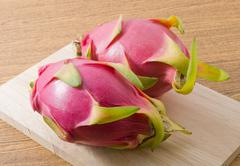 Fresh Fruits, Ripe and Sweet Dragon Fruits or Pitaya on A Wooden Cutting Boar Stock Photos