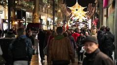 People walking in Oxford Street with Christmas decorations London Stock Footage