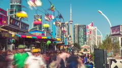 Toronto CNE The Ex Day Fair Crowds Rides Games Festival CN Tower Time-lapse 2 Stock Footage