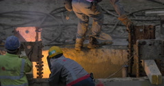 View of worker welding reinforcement of constructed building. Hong Kong, China Stock Footage