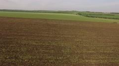 Plowed Farm Field Under Grey Sky Stock Footage
