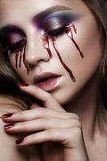 Beautiful young model with bright make-up Stock Photos