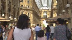 Tourist people enjoy Galleria Vittorio Emanuele in Milan famous shopping area Stock Footage