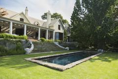 Home showcase exterior with swimming pool and tree Stock Photos
