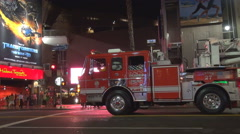 American fire track wait at stop light Los Angeles traffic car avenue rush hour Stock Footage
