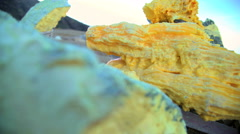 Sulphur blocks mined by local workers mountain volcano Java Stock Footage