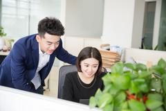 Young boss and assistant at work Stock Photos