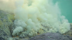View of sulphur mining mountain volcano crater with acidic lake Ijen Java Stock Footage