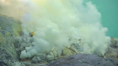 Sulphur mining mountain volcano crater with acidic lake Ijen Java Stock Footage