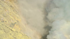 Sulphur mined by local workers on mountain volcano Java Indonesia Stock Footage