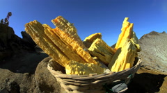 Sulphur blocks mined by local workers on mountain volcano Java Stock Footage