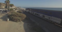 Pedestal Up of the Amtrak Pacific Surfliner at the San Clemente State Beach Arkistovideo