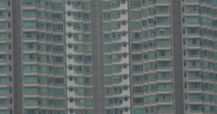 Block of flats and working building crane Stock Footage