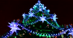 Christmas tree shining blue stars and colored lights Stock Footage