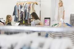 Fashion buyers examining clothing Kuvituskuvat