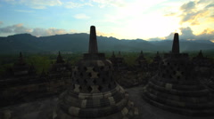 Sunset over Borobudur a religious ruined temple Java Indonesia Stock Footage