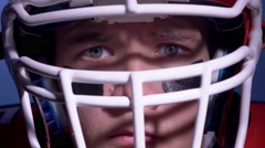 An American football player touching his helmet Stock Footage